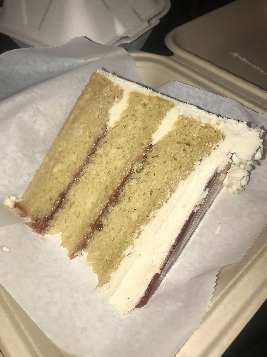 """Photo of Dulce Vegan Bakery and Cafe  by <a href=""""/members/profile/SamTyler"""">SamTyler</a> <br/>Lemon Raspberry Slice <br/> May 13, 2018  - <a href='/contact/abuse/image/26735/399380'>Report</a>"""