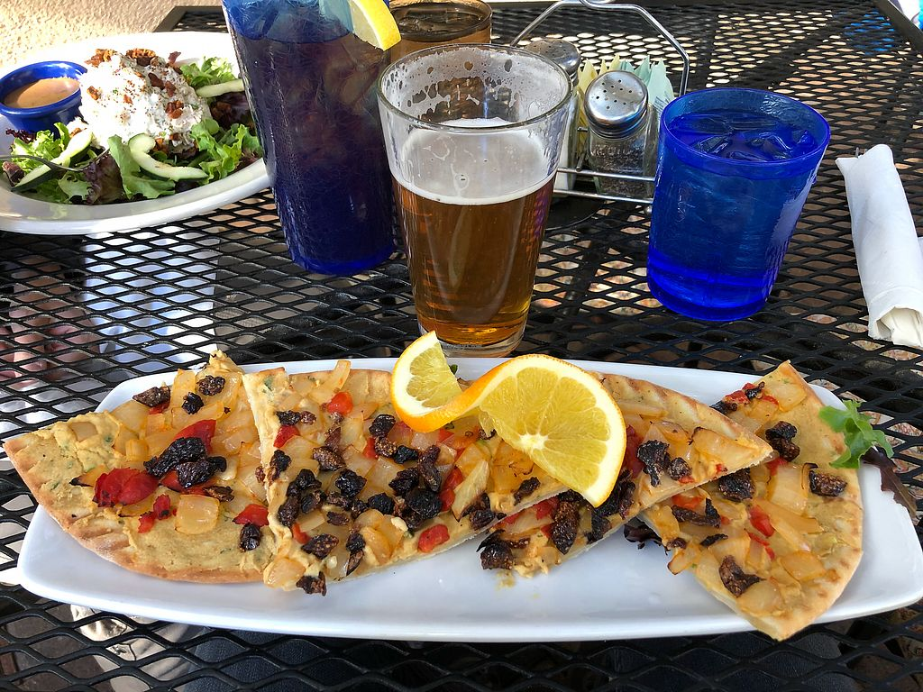 """Photo of Secret Garden Cafe  by <a href=""""/members/profile/oskeewowwow"""">oskeewowwow</a> <br/>Hummus pizza. Costs extra $ to make vegan because of the gluten free crust even though they remove the feta <br/> November 20, 2017  - <a href='/contact/abuse/image/26898/327357'>Report</a>"""