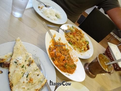 """Photo of Gokul Vegetarian Restaurant and Cafe- Fortune Centre  by <a href=""""/members/profile/AndreaPassini"""">AndreaPassini</a> <br/>sesame naan, spicy paneer curry, lentil curry, fried noodles <br/> January 3, 2013  - <a href='/contact/abuse/image/26929/42279'>Report</a>"""