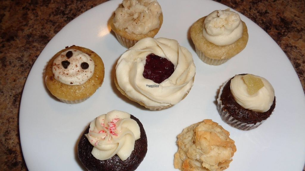 """Photo of Vegan Sweet Tooth  by <a href=""""/members/profile/GeaugaVegan"""">GeaugaVegan</a> <br/>Holiday assortment of cupcakes (including chocolate peppermint, gingerbread, orange cranberry), and a coconut macaroon.  <br/> August 24, 2016  - <a href='/contact/abuse/image/27162/171295'>Report</a>"""