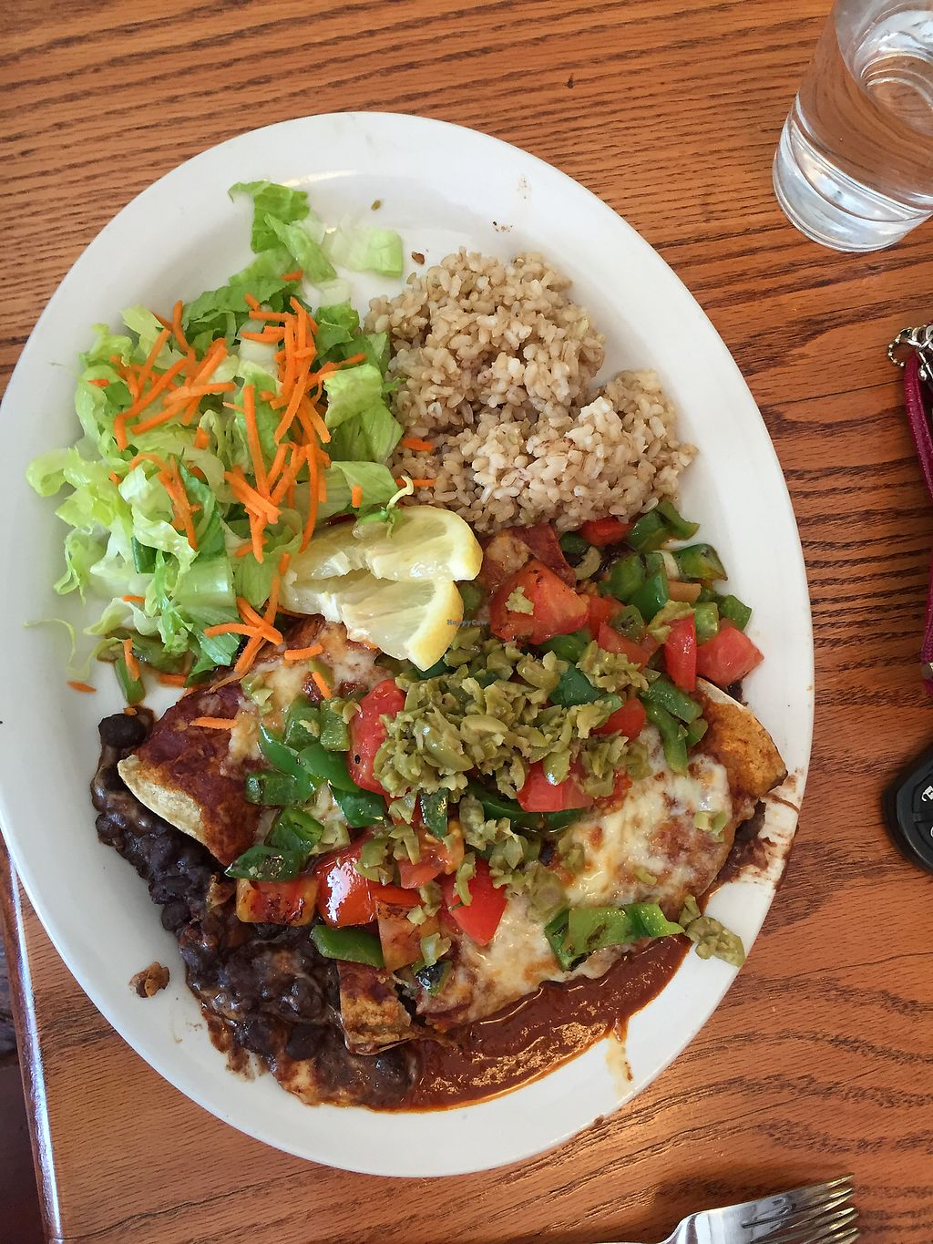 "Photo of Inn Season Cafe  by <a href=""/members/profile/MelindaTowns"">MelindaTowns</a> <br/>Enchiladas <br/> August 6, 2017  - <a href='/contact/abuse/image/2727/289472'>Report</a>"