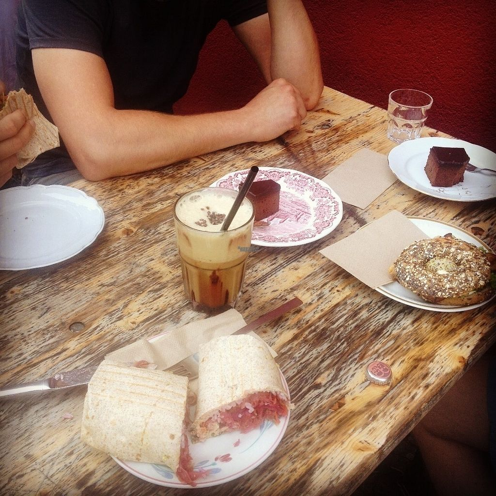 """Photo of Goodies Cafe - Veganz Schivelbeiner Str  by <a href=""""/members/profile/o0Carolyn0o"""">o0Carolyn0o</a> <br/>Kimchi wrap, coffee, cakes, and bagel sandwich <br/> October 4, 2016  - <a href='/contact/abuse/image/27316/179719'>Report</a>"""