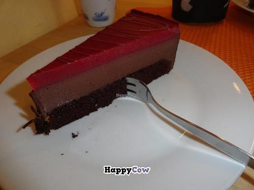"""Photo of Goodies Cafe - Veganz Schivelbeiner Str  by <a href=""""/members/profile/JonJon"""">JonJon</a> <br/>Raspberry-chocolate cheesecake <br/> November 7, 2013  - <a href='/contact/abuse/image/27316/58086'>Report</a>"""