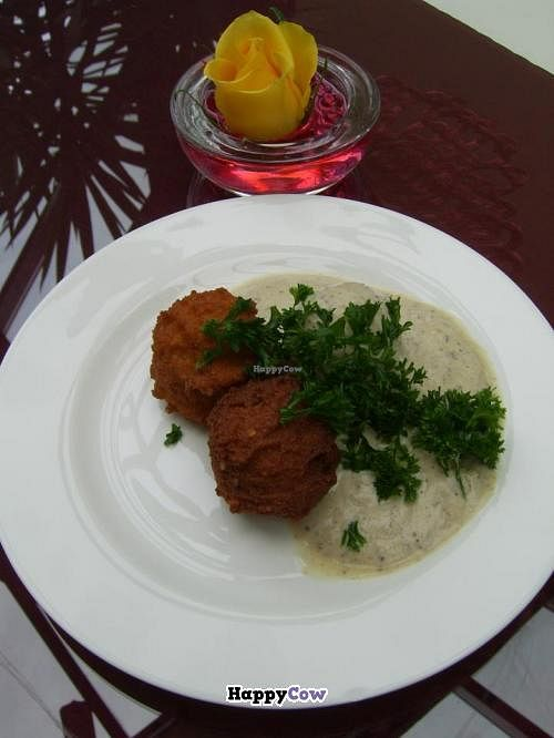 """Photo of Govinda's Restaurant  by <a href=""""/members/profile/Eli%20Rainbow"""">Eli Rainbow</a> <br/>Spicy potato pakoras in a soothing yogurt and parsley sauce. Yum! <br/> August 5, 2013  - <a href='/contact/abuse/image/27585/52767'>Report</a>"""