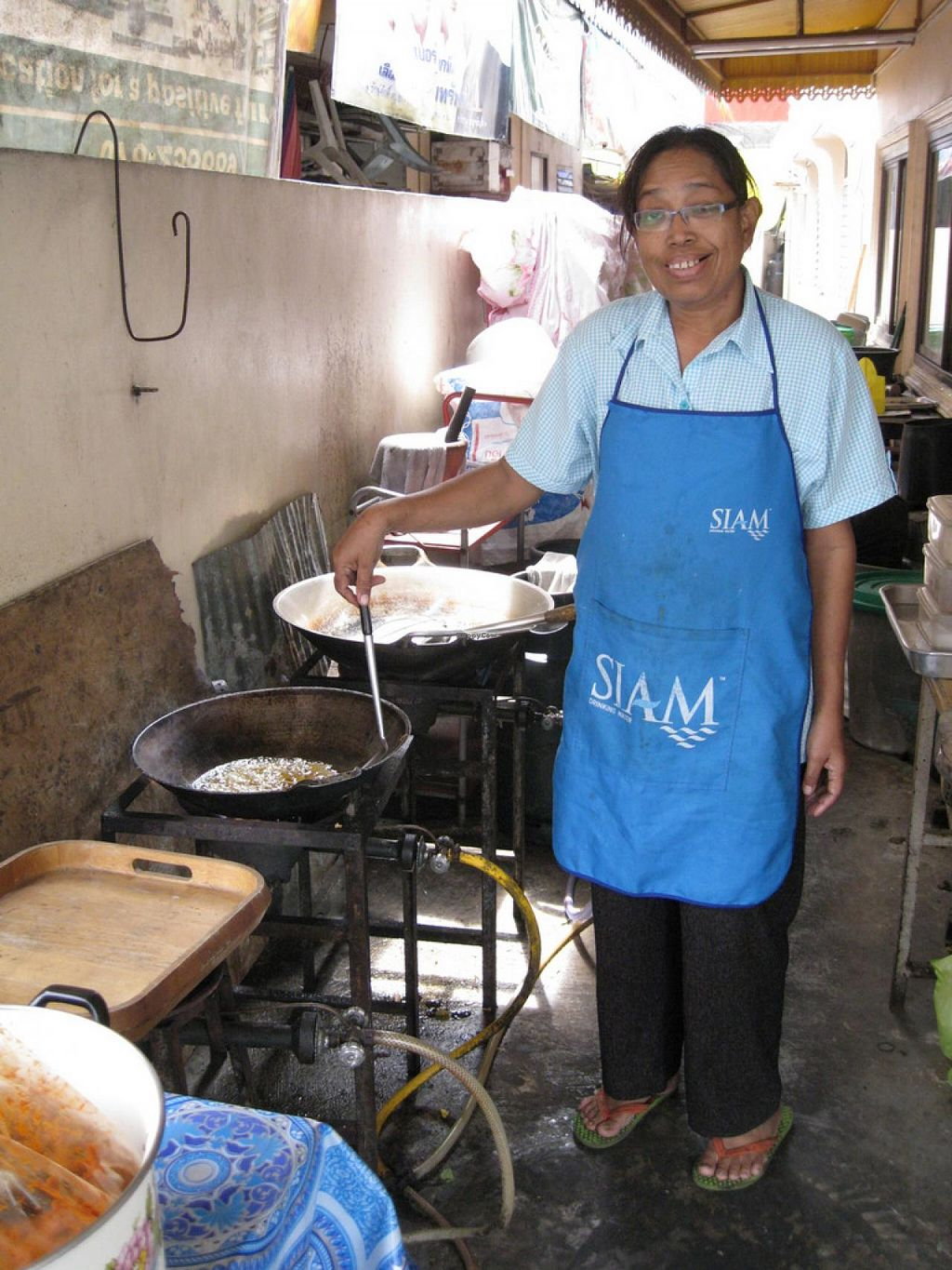 """Photo of Vegetarian Food - Patong  by <a href=""""/members/profile/KasperHansen"""">KasperHansen</a> <br/>One of the sweet ladies that worked there. She is making a mock duck dish for me, to take to the airport next day - since there is never any food there I want <br/> January 7, 2014  - <a href='/contact/abuse/image/27964/62026'>Report</a>"""