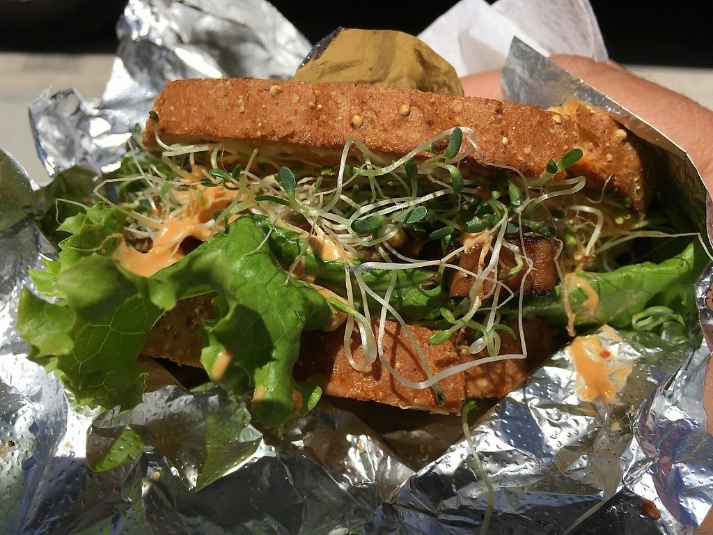 """Photo of Veggie Love Food Truck  by <a href=""""/members/profile/pm011"""">pm011</a> <br/>This is their curry cashew tempeh sandwich. It's delicious, however you're paying a high price for it. I guess it's paying for the West Palm area <br/> April 1, 2017  - <a href='/contact/abuse/image/28195/243432'>Report</a>"""