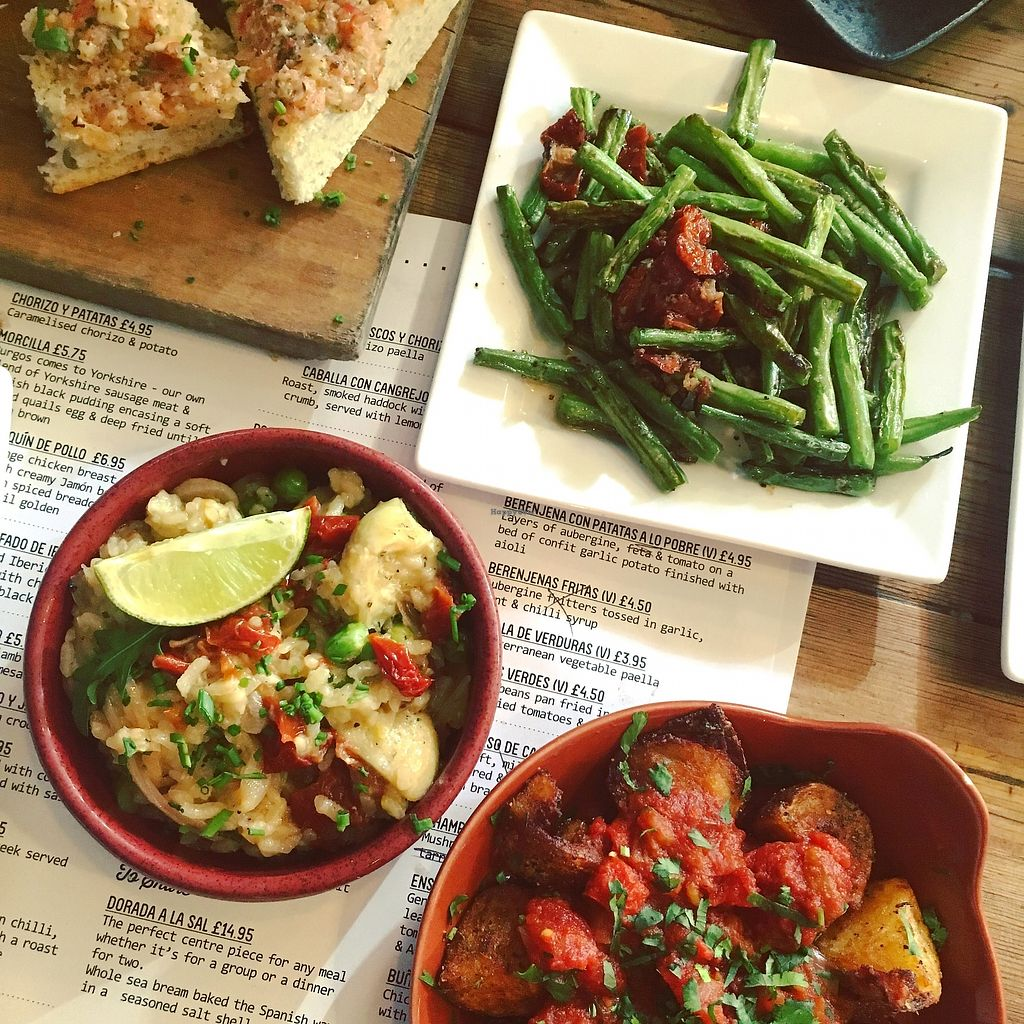 """Photo of Ambiente Tapas - Goodramgate  by <a href=""""/members/profile/SarahMoyes"""">SarahMoyes</a> <br/>Vegan tapas - bread with tomorro and garlic, green beans, veggie paella and potato bravas  <br/> April 17, 2018  - <a href='/contact/abuse/image/28304/387302'>Report</a>"""