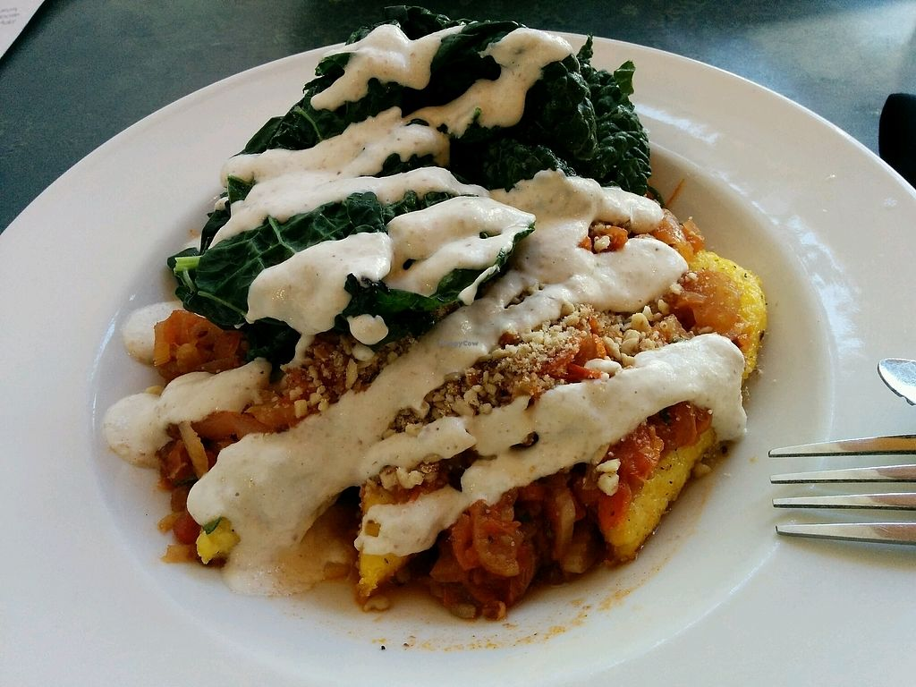 """Photo of Cafe Gratitude  by <a href=""""/members/profile/alexandra_vegan"""">alexandra_vegan</a> <br/>Warm-hearted Pan Seared Polenta with extra sauteed kale - delish <br/> October 3, 2017  - <a href='/contact/abuse/image/28319/311527'>Report</a>"""