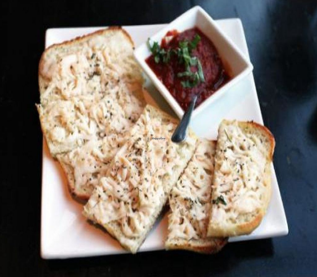 """Photo of EVO Kitchen  by <a href=""""/members/profile/quarrygirl"""">quarrygirl</a> <br/>Vegan garlic cheese bread with marinara dip <br/> December 26, 2011  - <a href='/contact/abuse/image/28851/187854'>Report</a>"""