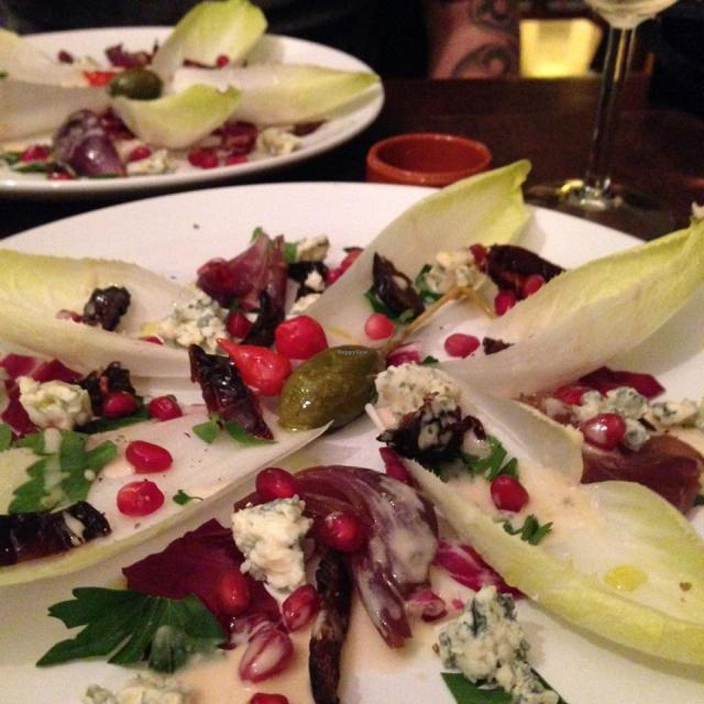 "Photo of Marits Eetkamer  by <a href=""/members/profile/Lizardjones"">Lizardjones</a> <br/>chicory and blue cheese salad with pomegranates and dried plums <br/> November 15, 2014  - <a href='/contact/abuse/image/28877/85664'>Report</a>"