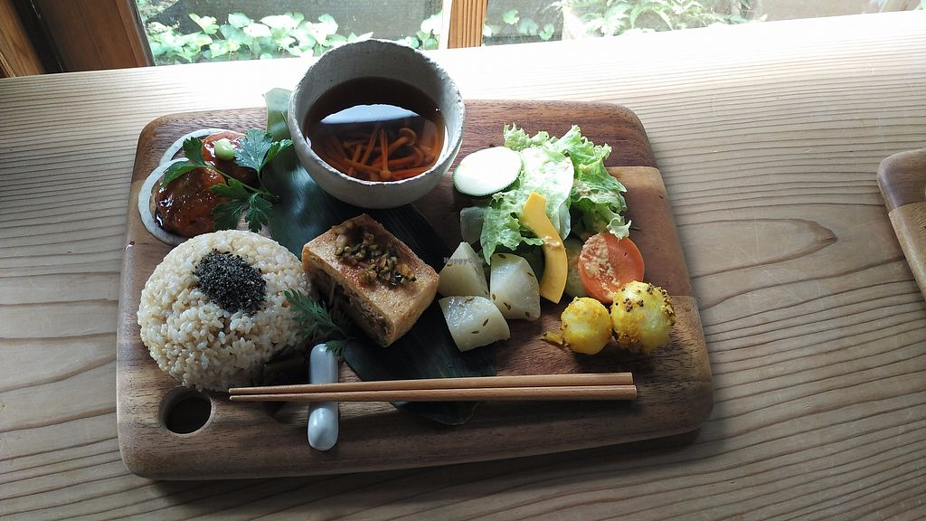 """Photo of Yasai Cafe Meguri  by <a href=""""/members/profile/LaiNamKhim"""">LaiNamKhim</a> <br/>A platter of small dishes served on a chopping board. The sprouted rice served with sesame is delicious on its own! <br/> July 12, 2017  - <a href='/contact/abuse/image/28944/279523'>Report</a>"""