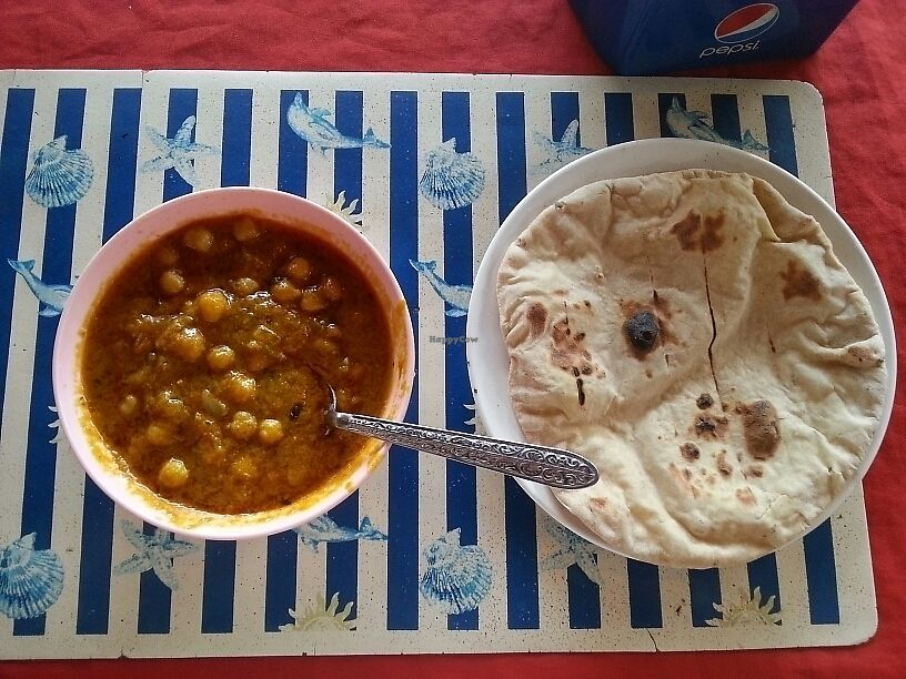 """Photo of Nazim Indian Restaurant  by <a href=""""/members/profile/WillChadwick"""">WillChadwick</a> <br/>chana masala (chickpeas) with chapatti <br/> June 21, 2017  - <a href='/contact/abuse/image/28974/271761'>Report</a>"""