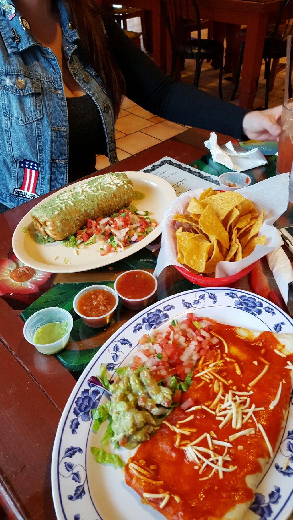 """Photo of El Papagayo  by <a href=""""/members/profile/HollyGreasyVegan"""">HollyGreasyVegan</a> <br/>Vegan Chimichanga in green sauce & a vegan quesadilla with red sauce.  <br/> March 31, 2016  - <a href='/contact/abuse/image/29059/142007'>Report</a>"""