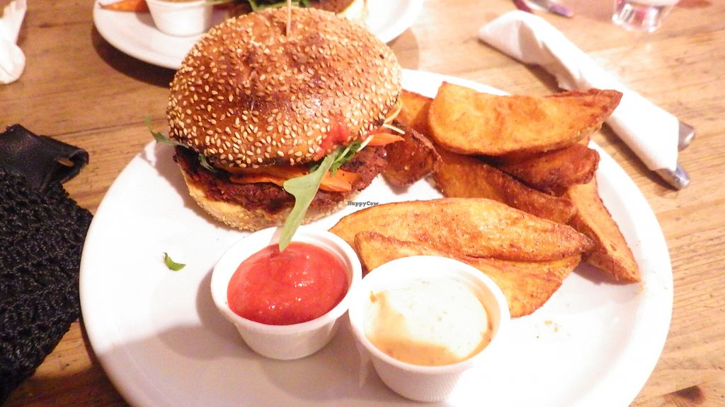 """Photo of EmmaPea Vegan Food and Bar  by <a href=""""/members/profile/deadpledge"""">deadpledge</a> <br/>Beet Burger and tandoori wedges <br/> June 28, 2017  - <a href='/contact/abuse/image/29099/274284'>Report</a>"""