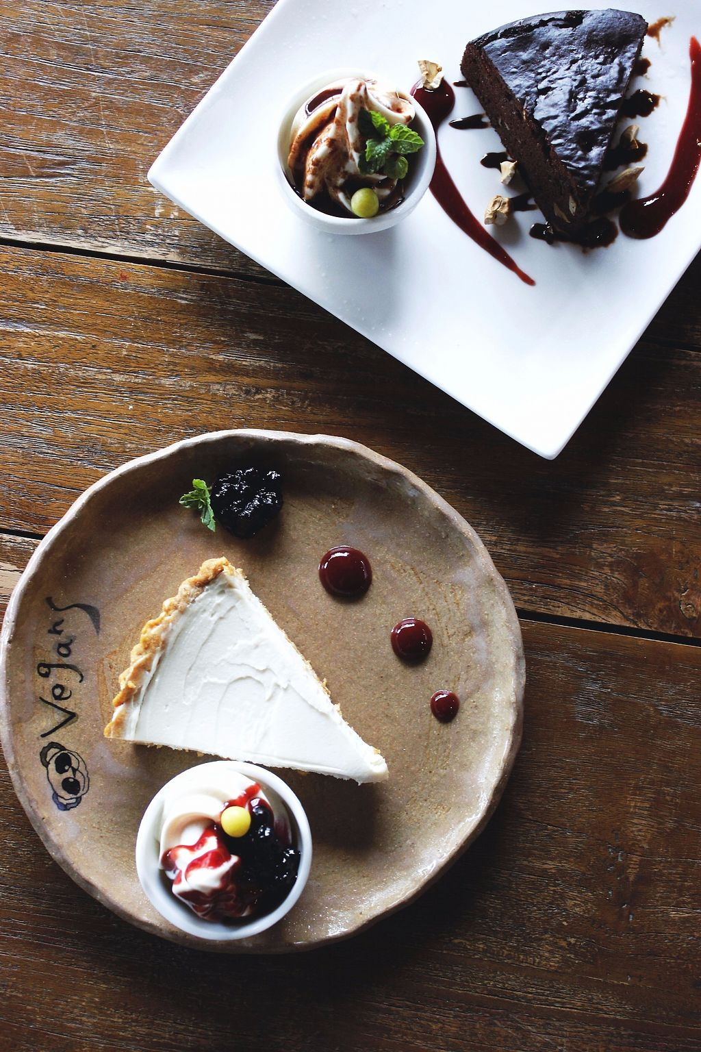 """Photo of Vegans Cafe and Restaurant  by <a href=""""/members/profile/YukiLim"""">YukiLim</a> <br/>Vegan lemon cheesecake and chocolate cake from Vegans Cafe <br/> July 16, 2017  - <a href='/contact/abuse/image/29114/280814'>Report</a>"""