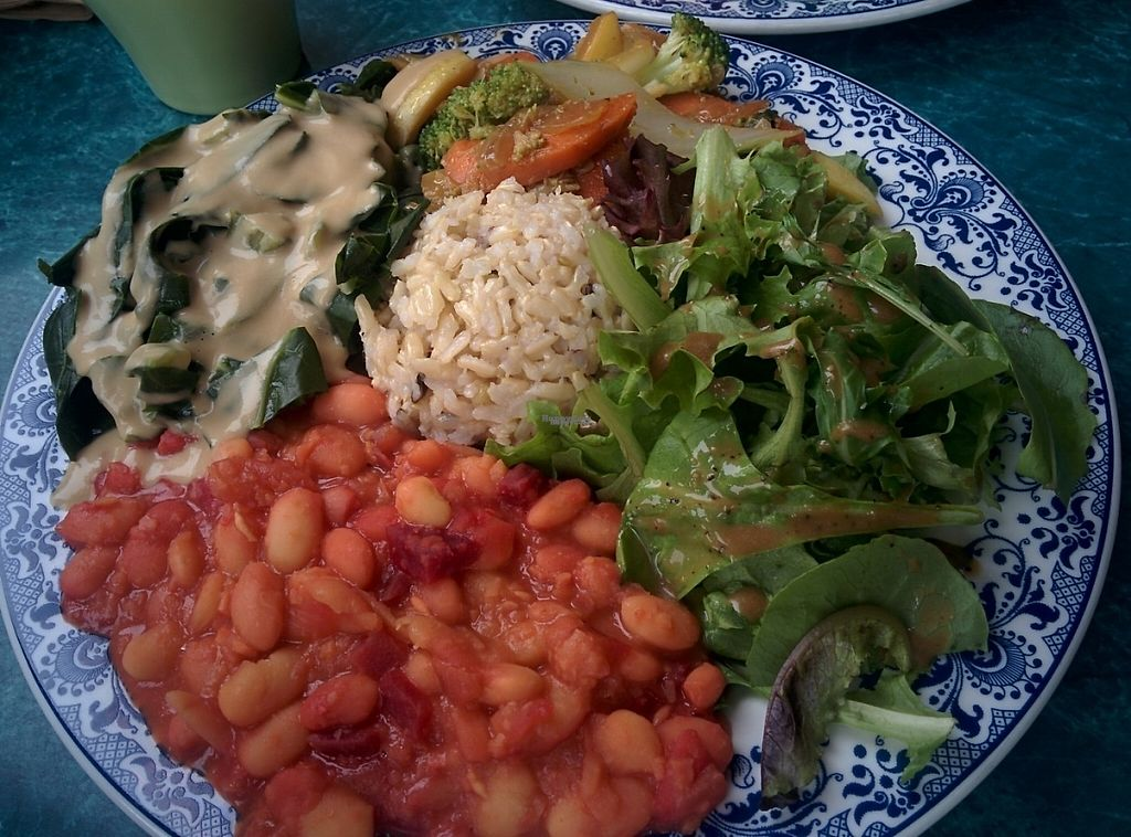 """Photo of Potala Organic Cafe  by <a href=""""/members/profile/MizzB"""">MizzB</a> <br/>A full meal includes soup, rice, legumes, greens, mixed vegetables, and salad. Today's meal: Wild Brown Rice, Northern Bean with Onion Beets, Sauteed Bok Choy Carrot Broccoli Yellow Squash, Steamed Collard Greens with Shiitake Mushroom Onion Sauce, Mixed Green Salad with Balsamic Vinegar Mint Tahini Dressing <br/> December 8, 2016  - <a href='/contact/abuse/image/29240/198127'>Report</a>"""