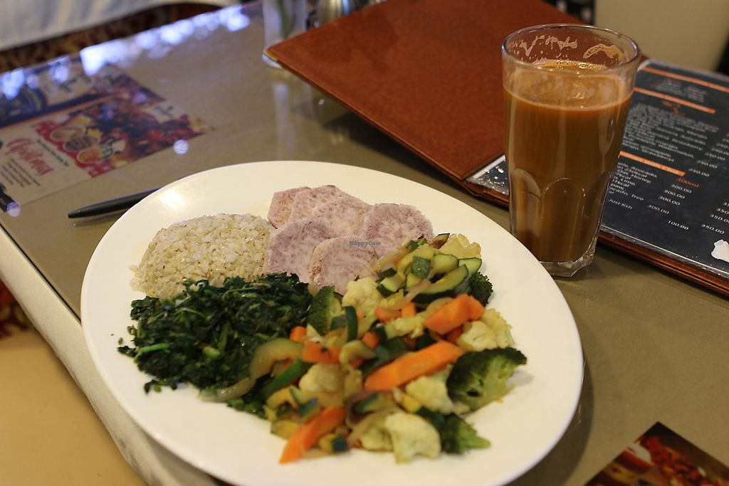 """Photo of Bridges Organic Health Restaurant  by <a href=""""/members/profile/LaitioRamone"""">LaitioRamone</a> <br/>This meal has for example arrow roots, rice and mixed vegetables that had 6-7 different vegetables. Also is freshly made organic juice that had carrots, apple and spinach.  <br/> December 16, 2017  - <a href='/contact/abuse/image/29336/336244'>Report</a>"""