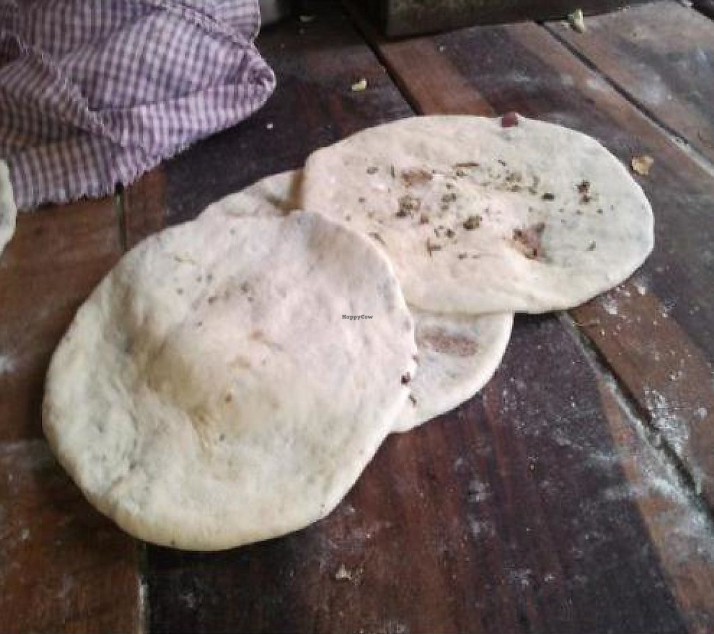 "Photo of Majha Kulcha Shop  by <a href=""/members/profile/amanbir.singh"">amanbir.singh</a> <br/>Step 2 - Rolled Bread <br/> December 20, 2011  - <a href='/contact/abuse/image/29522/199644'>Report</a>"