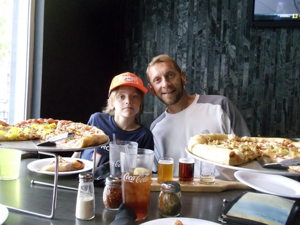"""Photo of Mellow Mushroom  by <a href=""""/members/profile/vegfam"""">vegfam</a> <br/>2 vegan pies with Daiya, tempeh, onions, banana peppers and artichoke hearts.  <br/> July 24, 2014  - <a href='/contact/abuse/image/29852/74947'>Report</a>"""