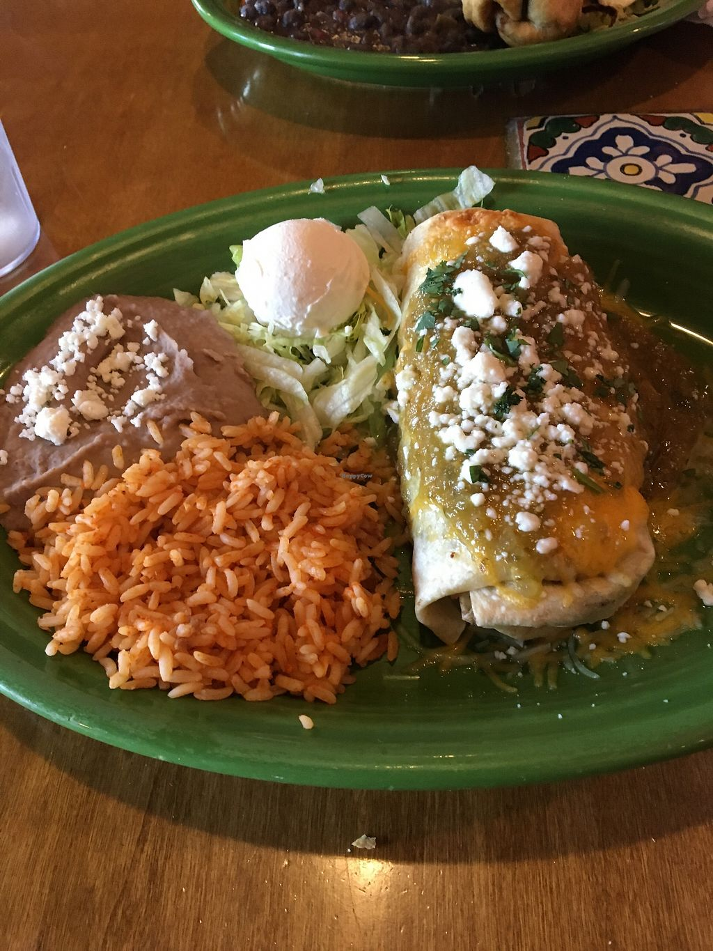 """Photo of Miguel's Mexican Restaurant  by <a href=""""/members/profile/sophiefrenchfry"""">sophiefrenchfry</a> <br/>Burrito Verde with Vegetarian Black Beans <br/> June 20, 2017  - <a href='/contact/abuse/image/30051/271507'>Report</a>"""