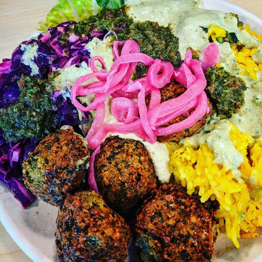 """Photo of Garbanzo Mediterranean Grill - Englewood  by <a href=""""/members/profile/Mtndarilia"""">Mtndarilia</a> <br/>Falafel plate with hummus, romaine lettuce, red cabbage, tomato & cucumber salad, seasoned rice and pickled red onions topped with cilanto & tahini sauces <br/> April 12, 2018  - <a href='/contact/abuse/image/30124/384653'>Report</a>"""