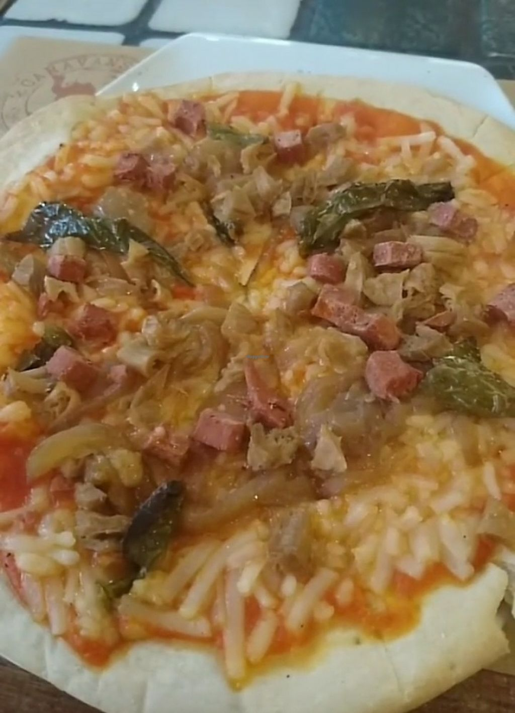 "Photo of Caravanserai  by <a href=""/members/profile/RenataScotti"">RenataScotti</a> <br/>Vegan chicken pizza <br/> May 30, 2017  - <a href='/contact/abuse/image/30196/264145'>Report</a>"