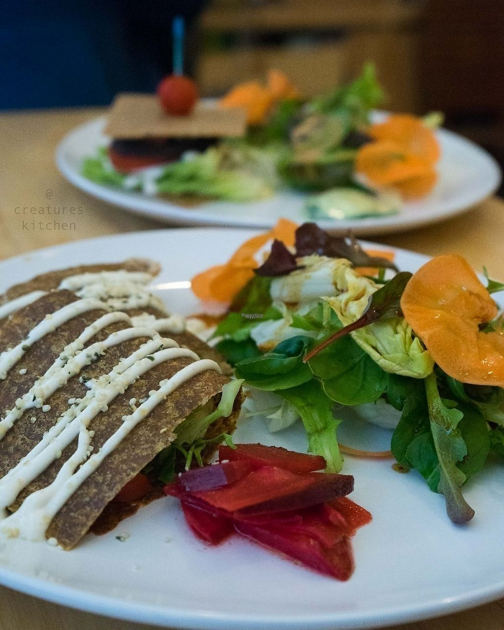 """Photo of Raw8 Cafe  by <a href=""""/members/profile/EmmaCebuliak"""">EmmaCebuliak</a> <br/>Raw quesadillas with salad, and the raw burger sandwich in the background.  <br/> January 27, 2017  - <a href='/contact/abuse/image/30371/217772'>Report</a>"""