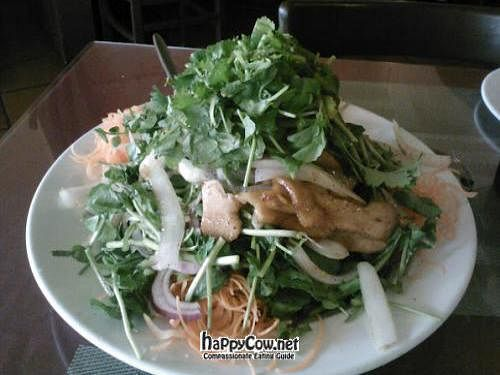 """Photo of Miss Saigon Bistro  by <a href=""""/members/profile/beticita"""">beticita</a> <br/>Seitan Cress vegan salad. A mound of delicious watercress with crispy seitan, raw carrots and onions with a sweet dressing <br/> April 8, 2012  - <a href='/contact/abuse/image/30478/30334'>Report</a>"""