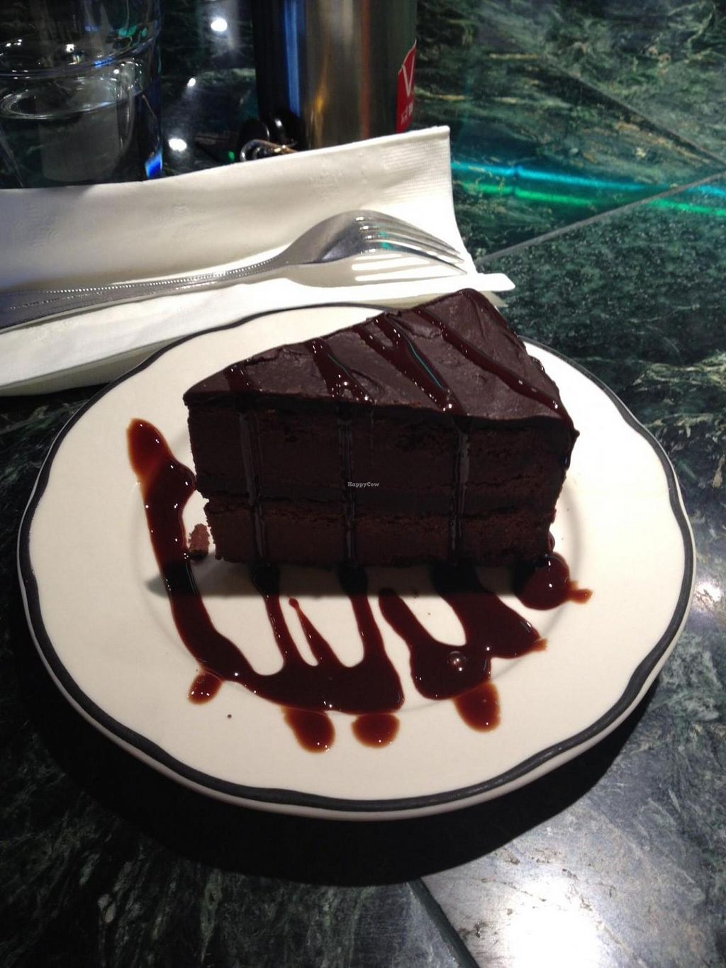 """Photo of Organic Oasis  by <a href=""""/members/profile/Sarah%20P"""">Sarah P</a> <br/>Vegan gluten-free chocolate cake <br/> August 5, 2014  - <a href='/contact/abuse/image/3087/76130'>Report</a>"""