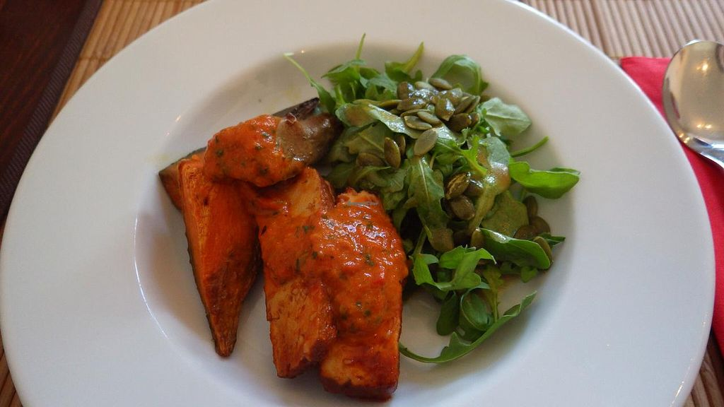 """Photo of The Bean Inn  by <a href=""""/members/profile/deadpledge"""">deadpledge</a> <br/>Smoked Tofu with Sweet Potato Wedges served with a rocket & pumpkin seed salad and a fiery harissa sauce  <br/> June 14, 2015  - <a href='/contact/abuse/image/3106/105882'>Report</a>"""