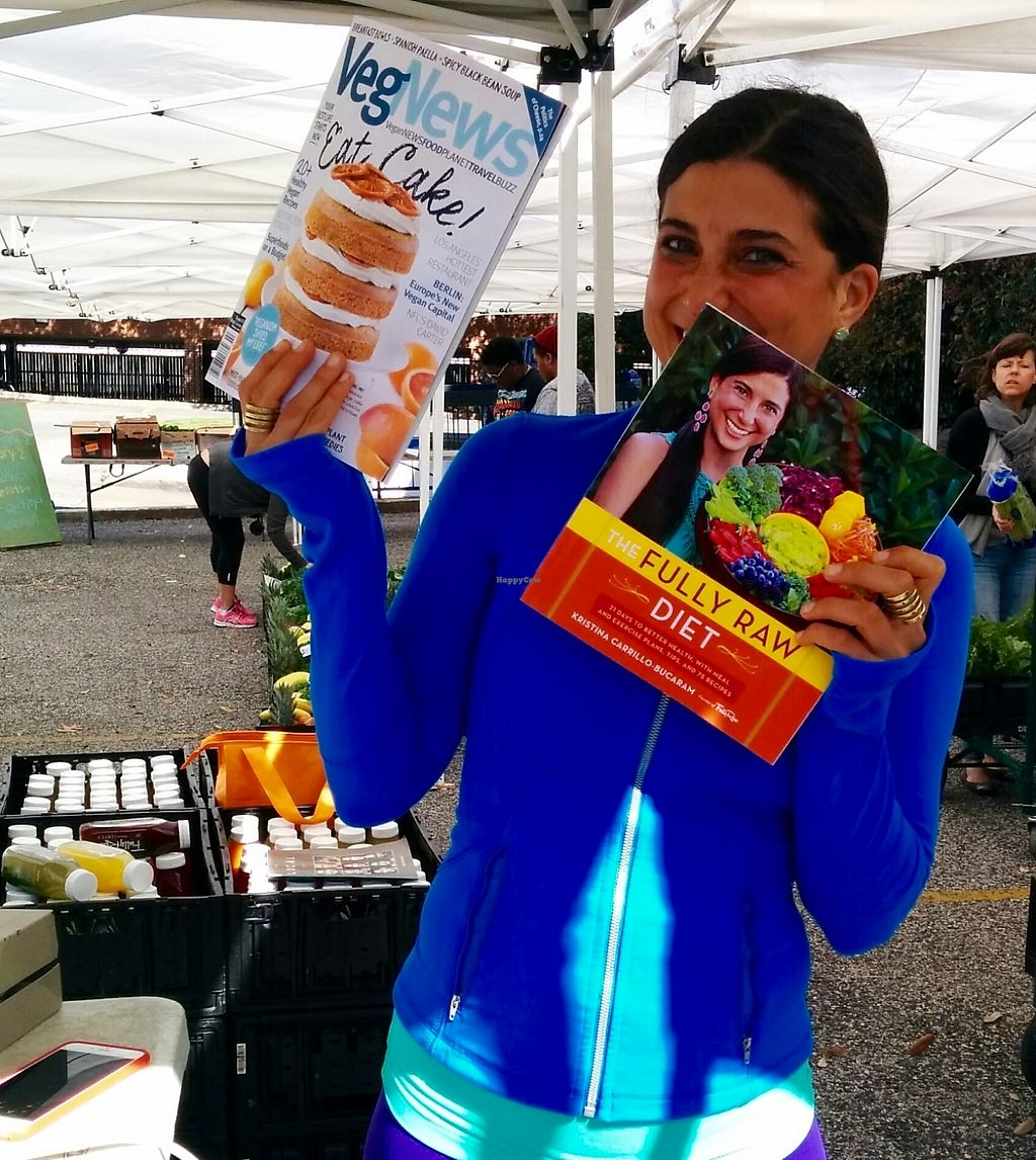 """Photo of CLOSED: Rawfully Organic Co-op  by <a href=""""/members/profile/MizzB"""">MizzB</a> <br/>Founder & chief co-operator Kristina Carillo-Bucaram with her newly published book, The Fully Raw Diet, and VegNews in which she contributed an article, 10 Things I Do To Stay Healthy <br/> January 30, 2016  - <a href='/contact/abuse/image/31360/229084'>Report</a>"""