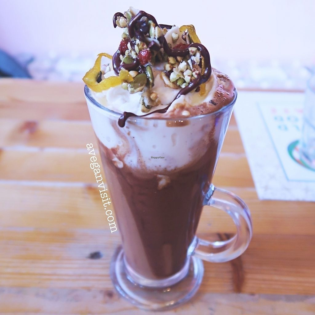 """Photo of Wild Food Cafe  by <a href=""""/members/profile/AVeganVisit.com"""">AVeganVisit.com</a> <br/>Orange hot chocolate with raw cacao, pumpkin seed milk, maple syrup, medicinal mushroom powder, tonka bean and orange zest.  Topped with coco whip and mixed sweet glazed seeds <br/> February 27, 2018  - <a href='/contact/abuse/image/31440/364435'>Report</a>"""