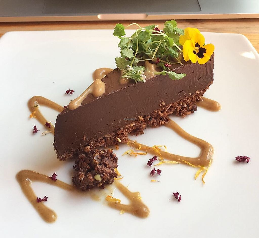 """Photo of Wild Food Cafe  by <a href=""""/members/profile/EmilePerron"""">EmilePerron</a> <br/>Raw chocolate tart, date syrup <br/> April 19, 2018  - <a href='/contact/abuse/image/31440/388173'>Report</a>"""