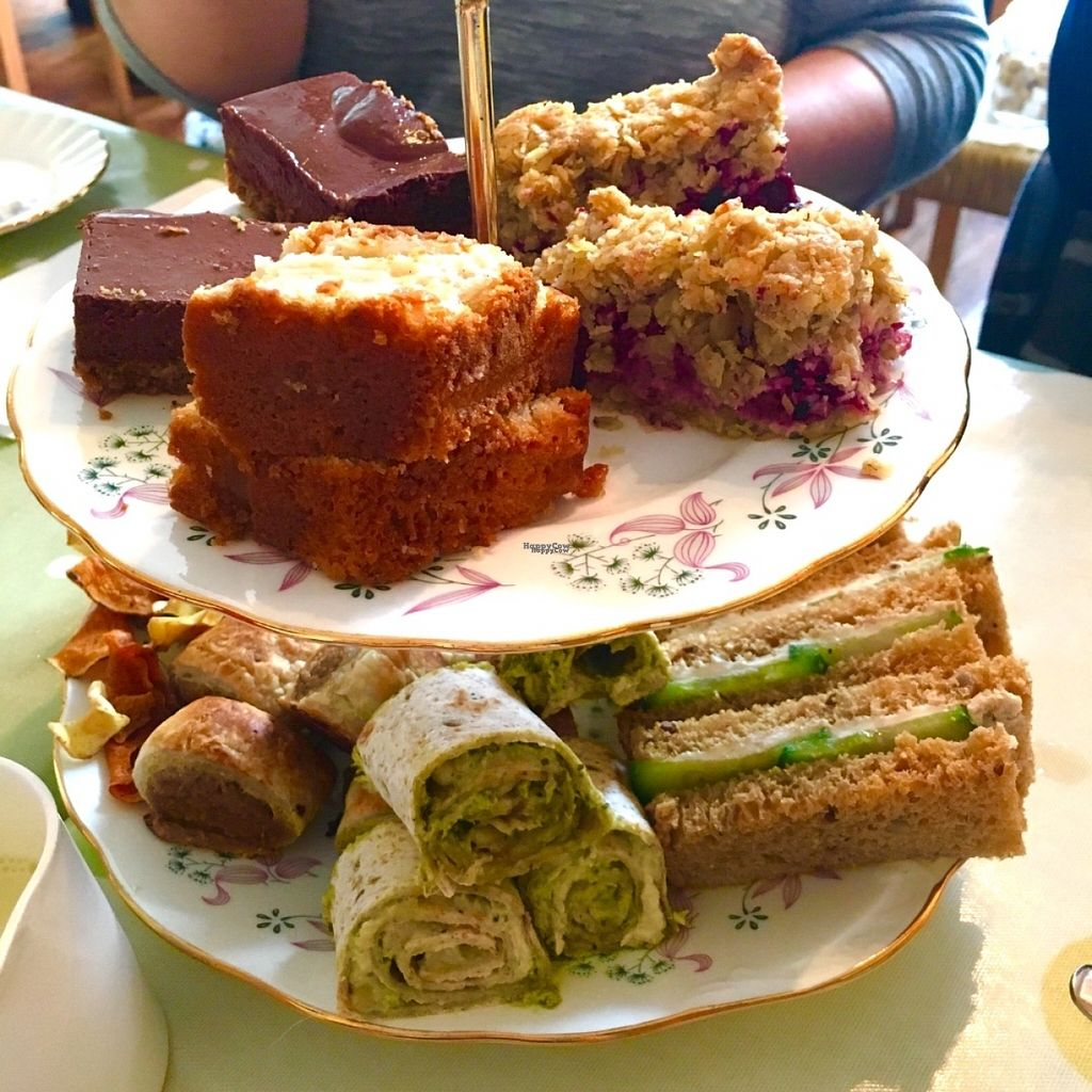 """Photo of Flying Goose Cafe  by <a href=""""/members/profile/Libra77"""">Libra77</a> <br/>Selection of cake, sandwiches, wrap, 'sausage' rolls and vegetable crisps  <br/> October 30, 2016  - <a href='/contact/abuse/image/31622/185386'>Report</a>"""