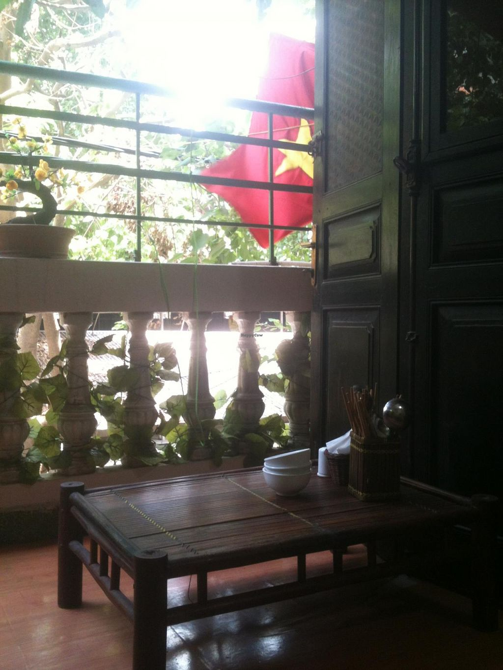 """Photo of An Phuc  by <a href=""""/members/profile/heloisepe"""">heloisepe</a> <br/>Second floor has a nice balcony, green, and still quiet because the restaurant is located in an alley <br/> July 5, 2015  - <a href='/contact/abuse/image/32126/108223'>Report</a>"""