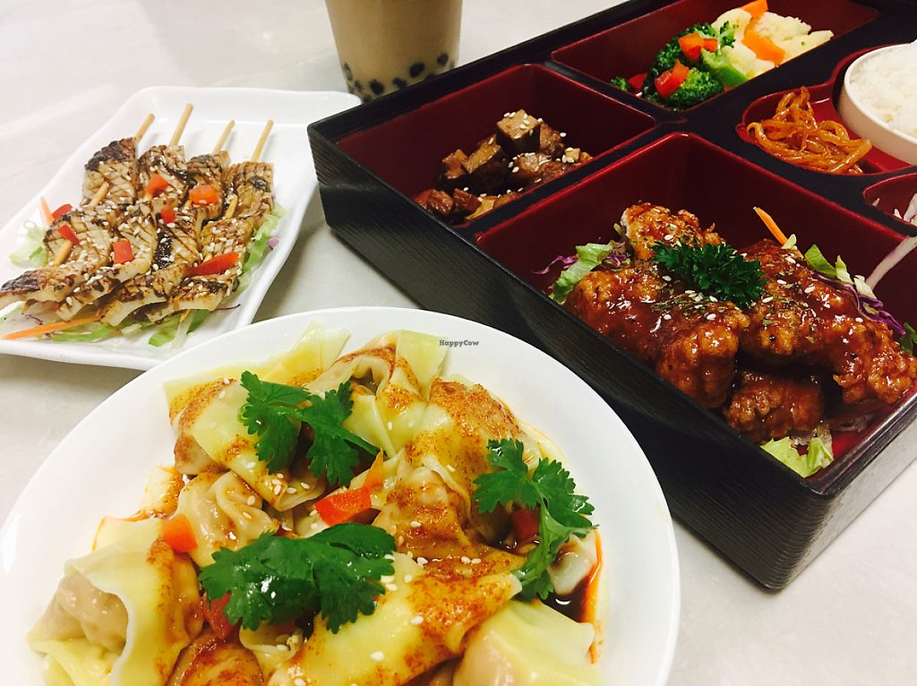 """Photo of Kuan Yin Tea House - Gold Coast  by <a href=""""/members/profile/clarklin"""">clarklin</a> <br/>wonton in chili oil, calamari skewer, sweet chili chicken rice.  <br/> May 19, 2017  - <a href='/contact/abuse/image/32167/260334'>Report</a>"""