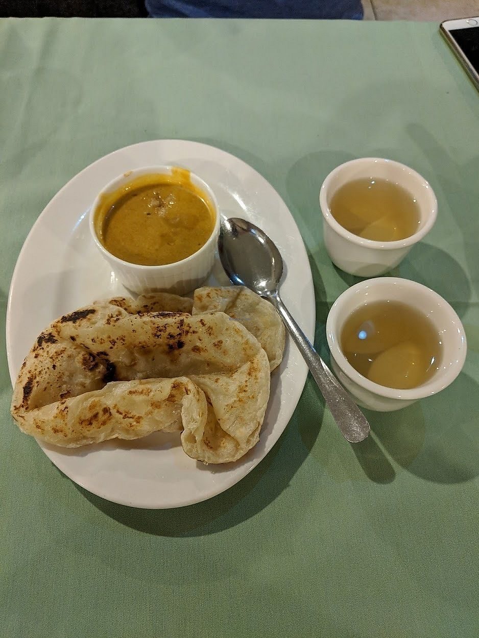 "Photo of Veggie House  by <a href=""/members/profile/theresabee"">theresabee</a> <br/>Roti with Curry <br/> November 20, 2017  - <a href='/contact/abuse/image/32168/327434'>Report</a>"