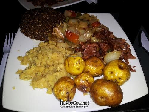"""Photo of Vital  by <a href=""""/members/profile/jrfishe1"""">jrfishe1</a> <br/>Lunch plate at Vital with yellow lentils, yellow potatoes, fake ham, and falafel <br/> June 12, 2012  - <a href='/contact/abuse/image/32182/33249'>Report</a>"""