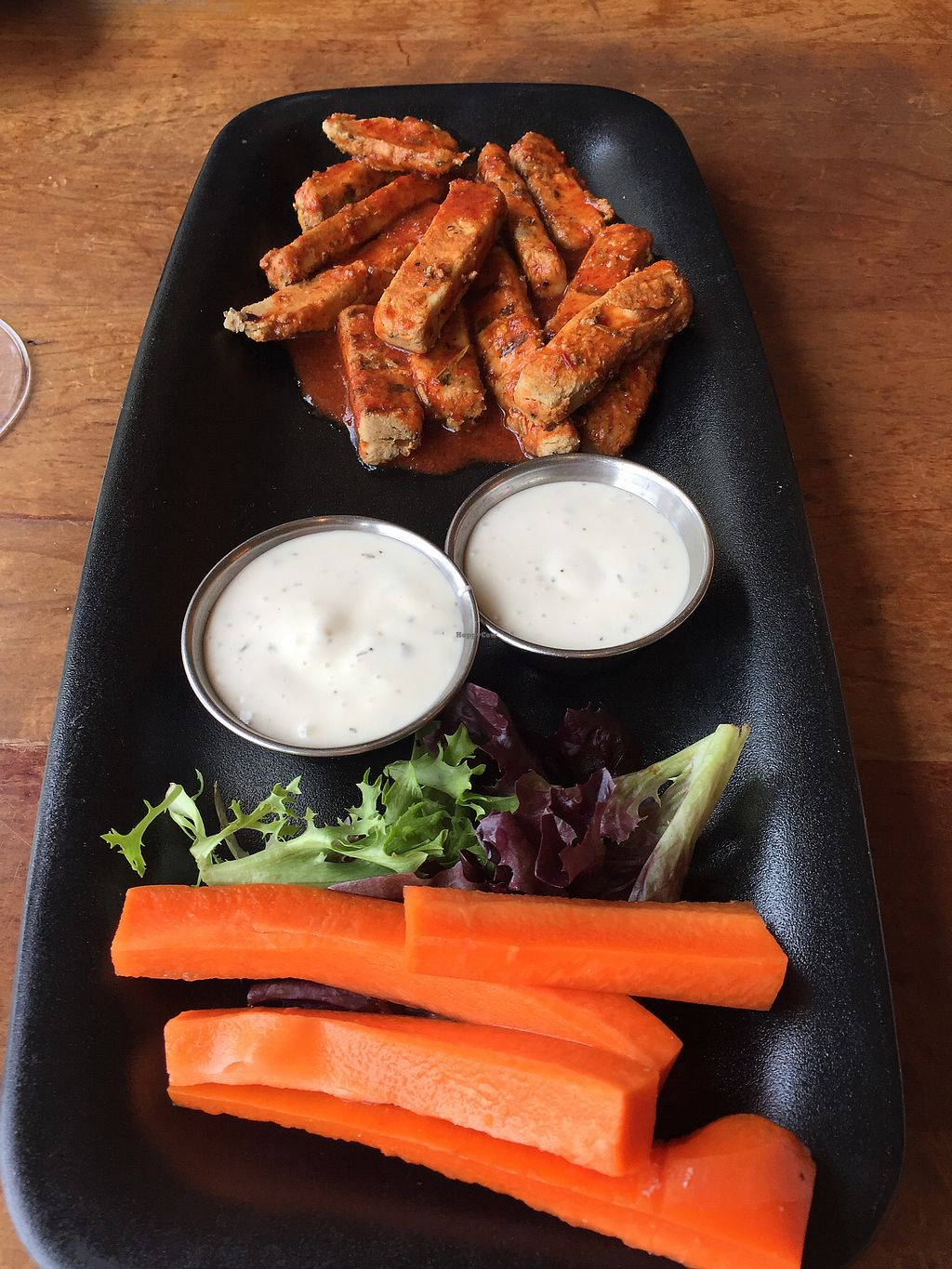 """Photo of Picazzo's Organic Italian Kitchen  by <a href=""""/members/profile/NickiPT"""">NickiPT</a> <br/>Beyond Meat chicken strips with buffalo sauce and vegan blue cheese! <br/> March 9, 2018  - <a href='/contact/abuse/image/32230/368486'>Report</a>"""
