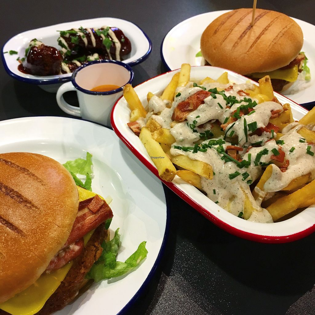"""Photo of V Rev Vegan Diner  by <a href=""""/members/profile/MorganCrawford"""">MorganCrawford</a> <br/>Burgers loaded fries and chicken <br/> February 21, 2018  - <a href='/contact/abuse/image/32339/362199'>Report</a>"""