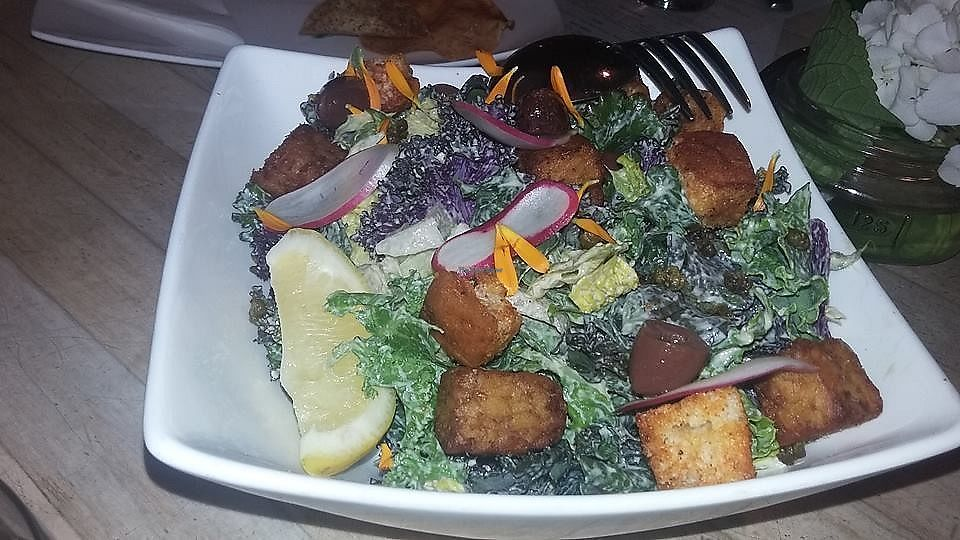 """Photo of The Acorn  by <a href=""""/members/profile/alicus"""">alicus</a> <br/>Kale Salad, Tempeh, Smoked Paprika Croutons, Crispy Capers, Black Olives, Caesar Dressing <br/> July 10, 2017  - <a href='/contact/abuse/image/32348/278524'>Report</a>"""