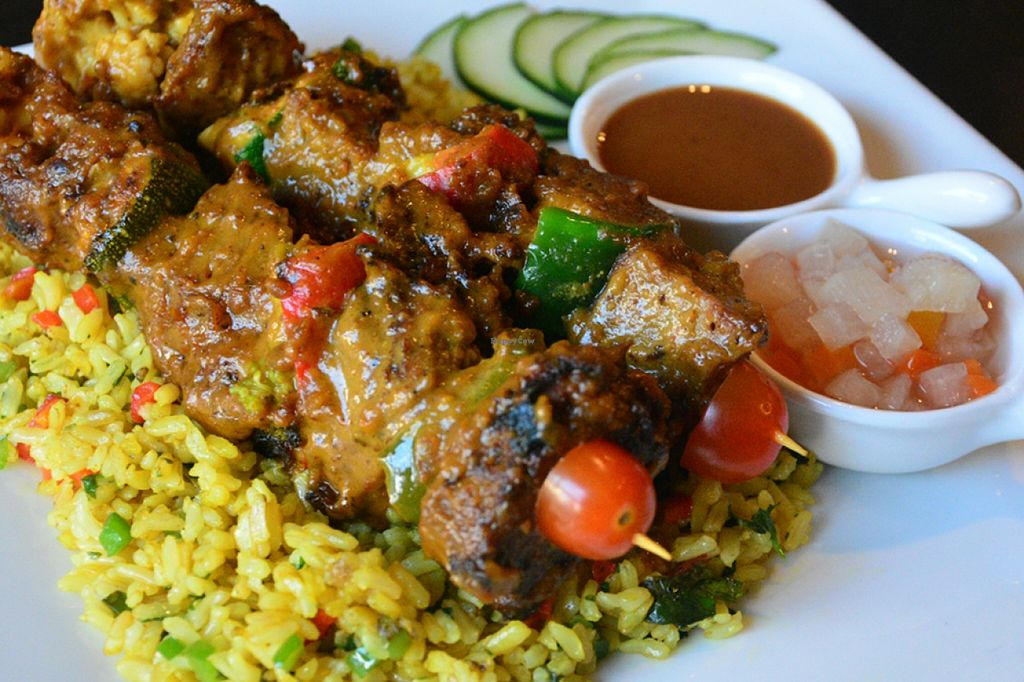 """Photo of The Vegetarian Kitchen  by <a href=""""/members/profile/konserns"""">konserns</a> <br/>Sate bbq on a bed of yellow rice <br/> May 23, 2016  - <a href='/contact/abuse/image/32430/150432'>Report</a>"""