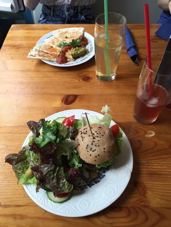 "Photo of Kombuse  by <a href=""/members/profile/EmKlu"">EmKlu</a> <br/>Black Bean Burger with mixed salad and Vegan Quesadilla <br/> July 12, 2016  - <a href='/contact/abuse/image/32500/159447'>Report</a>"