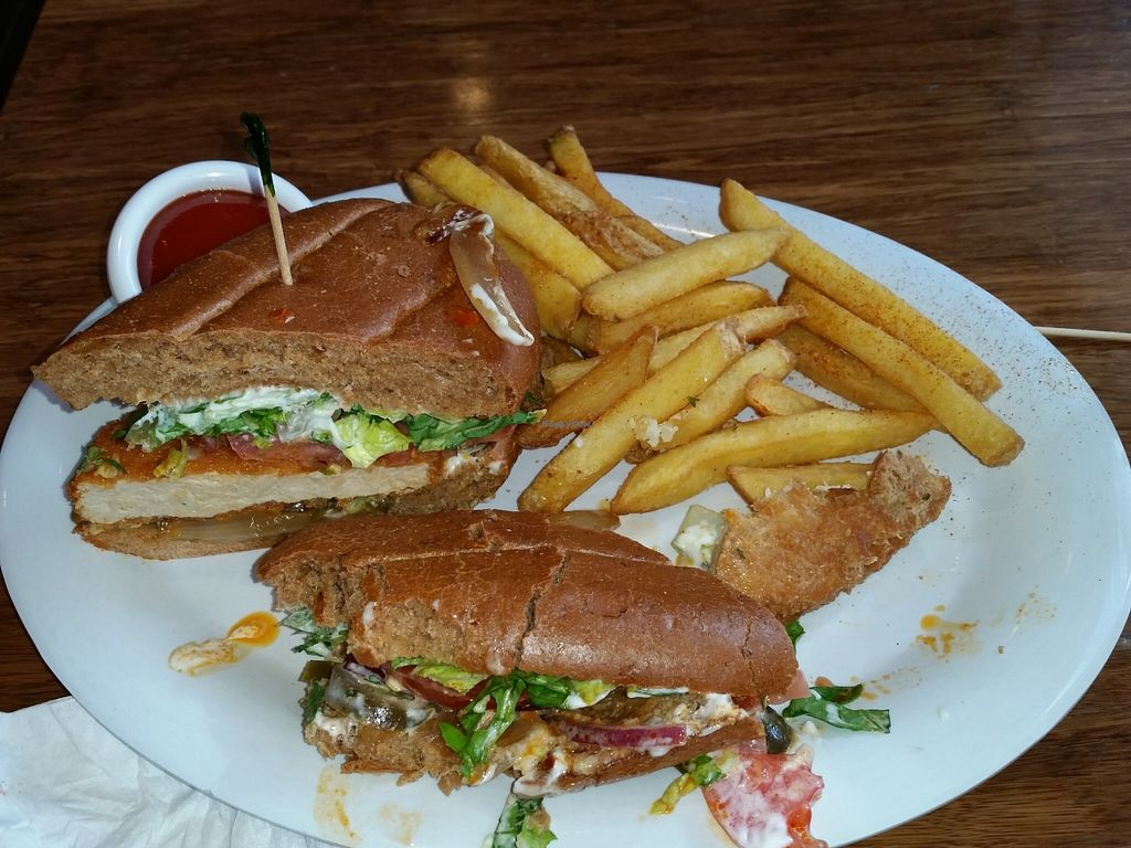 """Photo of Veggie Grill - Downtown Portland  by <a href=""""/members/profile/warmstorage"""">warmstorage</a> <br/>A buffalo bomber sandwich made 'El Dorado' style that I'm crushing! <br/> March 3, 2016  - <a href='/contact/abuse/image/32544/138621'>Report</a>"""