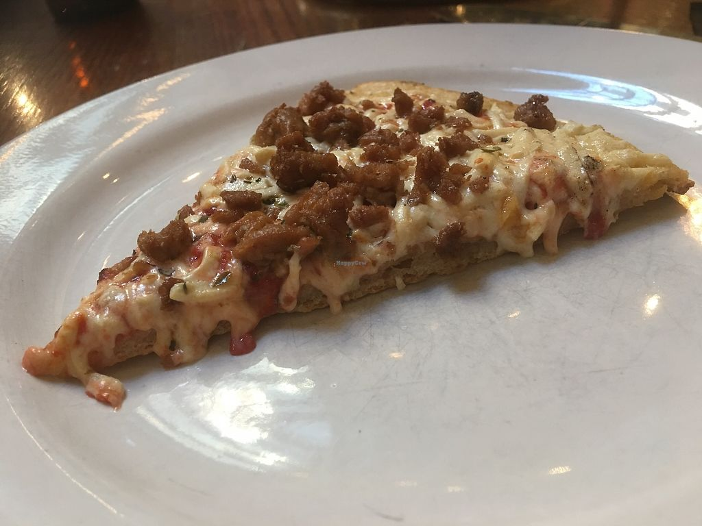 "Photo of District of Pi Pizzeria  by <a href=""/members/profile/Heatherd"">Heatherd</a> <br/>Vegan pizza with cheese and sausage <br/> June 29, 2017  - <a href='/contact/abuse/image/32562/274807'>Report</a>"