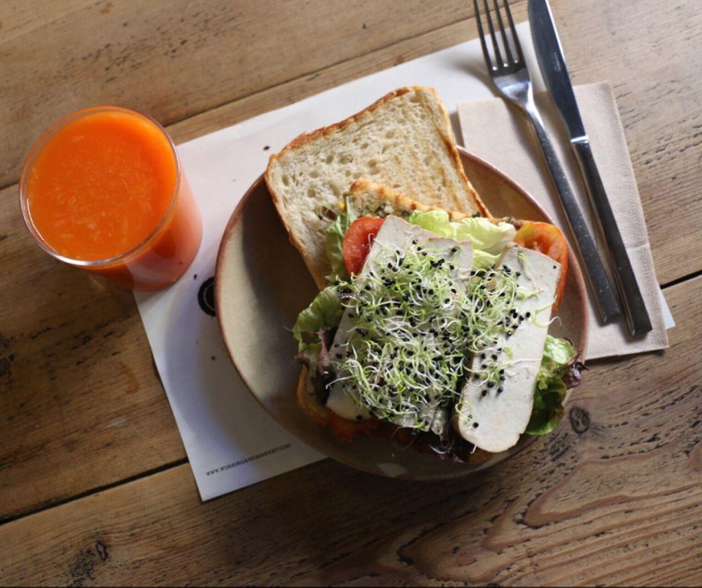 "Photo of Woki Organic Market and Restaurant  by <a href=""/members/profile/sunniezuleta"">sunniezuleta</a> <br/>carrot orange juice and smoked tofu sandwich (vegan) <br/> November 20, 2015  - <a href='/contact/abuse/image/32610/125545'>Report</a>"