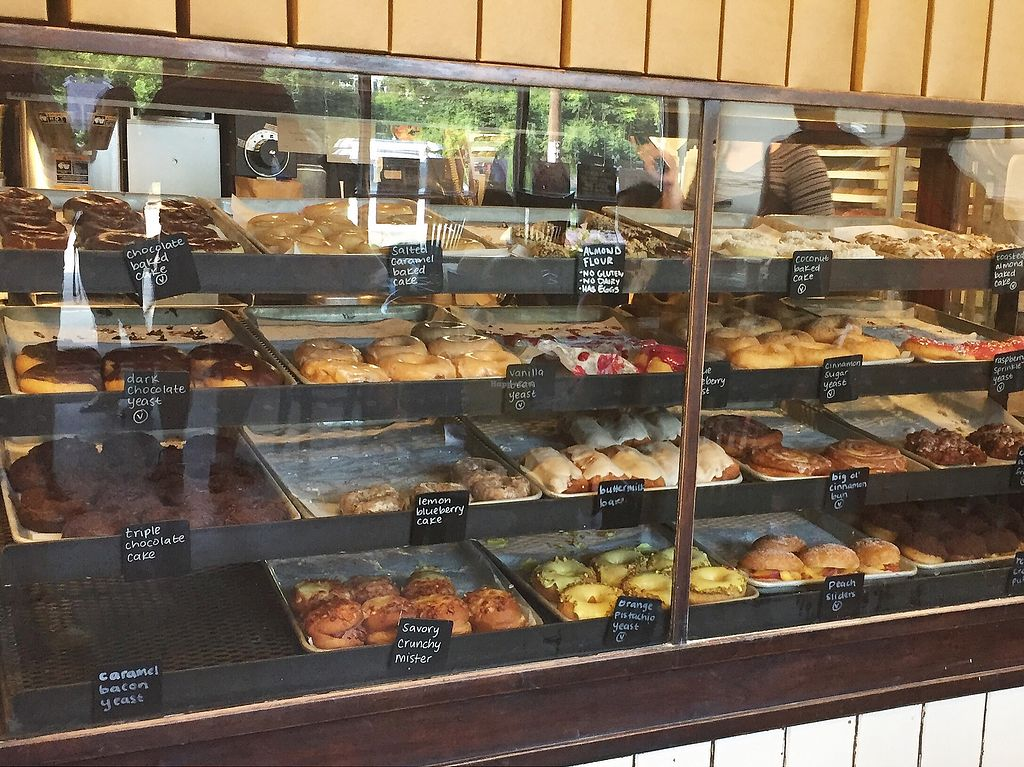 """Photo of Revolution Doughnuts  by <a href=""""/members/profile/RobinBobbin"""">RobinBobbin</a> <br/>Vegan options marked with a V on labels as well as on the wall behind the cashier  <br/> July 23, 2017  - <a href='/contact/abuse/image/32680/283798'>Report</a>"""