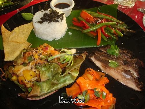 """Photo of CLOSED: Kaya Island Eats  by <a href=""""/members/profile/Sonja%20and%20Dirk"""">Sonja and Dirk</a> <br/>custom vegan plate:  pineapple tempeh in banana leaf, jerk portobello mushrooms, pickled carrots, veggies, wontons and rice <br/> March 16, 2013  - <a href='/contact/abuse/image/32801/45570'>Report</a>"""