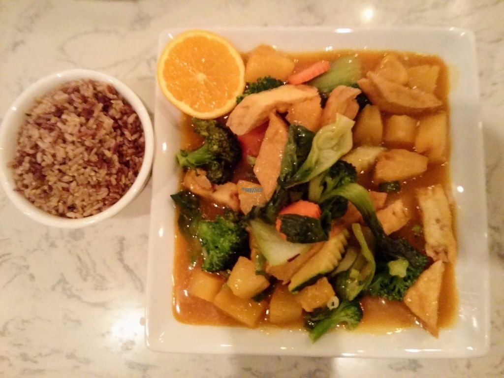 """Photo of Araya's Place  by <a href=""""/members/profile/fgsanz"""">fgsanz</a> <br/>Fried tofu with veggies in a super rich orange sauce, with brown rice on the side <br/> February 6, 2017  - <a href='/contact/abuse/image/32807/223528'>Report</a>"""