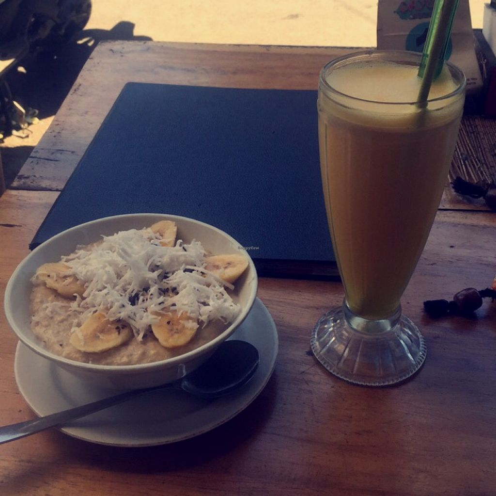 """Photo of Dayu's Warung  by <a href=""""/members/profile/bthevegantraveller"""">bthevegantraveller</a> <br/>Fresh juice and coconut porridge <br/> March 30, 2016  - <a href='/contact/abuse/image/32883/141895'>Report</a>"""
